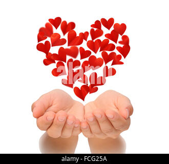 Hearts in heart shape flying over cupped hands of young woman, birthday card, love concept, isolated on white background - Stock Photo