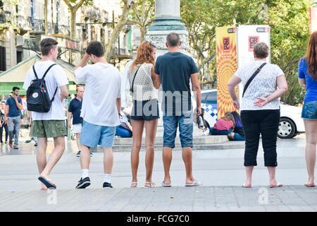 People waiting at a stoplight. Barcelona, Catalonia, Spain. - Stock Photo