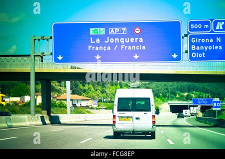 Arrival highway sign to La Jonquera before passing the border between Spain and France. La Jonquera, Catalonia, - Stock Photo