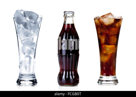 Bottle of cola with two glasses isolated on white background - Stock Photo