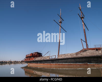 Grand Hermine vintage rusting ship permanently docked off of the QEW highway in the Niagara Region on Lake Ontario, - Stock Photo