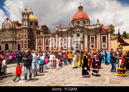 Native mexicans perform a traditional dance in costume, Basilica of Our Lady of Guadalupe (Basilica de Nuestra Señora - Stock Photo