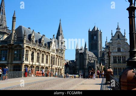 Historical center of Ghent. The old post office is on the left and on the right we can see Saint-Nicholas Church. - Stock Photo