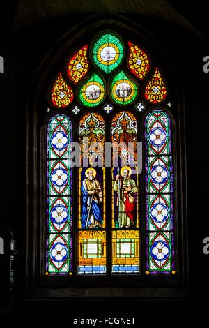 Stained glass window depicting Saints Matthew and Thomas, Notre-Dame Parish Church close, Saint-Thégonnec, Way of - Stock Photo