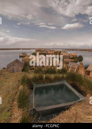 Floating village made of straw on Lake Titicaca, Peru, South America. - Stock Photo