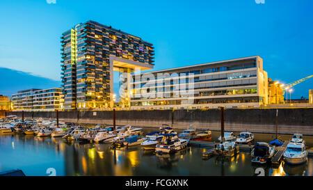 Germany Cologne Rheinauhafen marina and Kranhaus at blue hour - Stock Photo