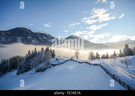 View to a winter landscape with mountain range and Gasteinertal valley near Bad Gastein, Pongau Alps - Salzburg - Stock Photo