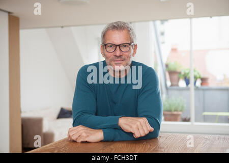 Portrait of mature man at home - Stock Photo