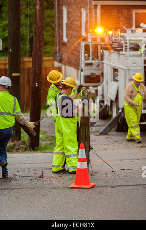 Workers replacing an electrical pole - Stock Photo