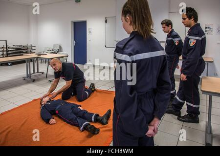 YOUNG FIREFIGHTERS, COURSE IN FIRST-AID - Stock Photo