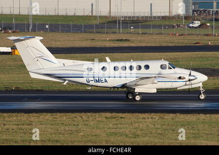 G-IMEA, a Beech King Air, back-tracks down Prestwick Airport's main runway before departure. - Stock Photo