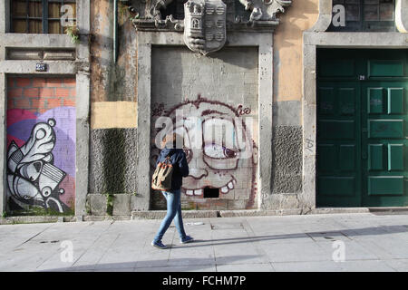 Street art at Rua das Flores in the old town of Porto in Portugal - Stock Photo