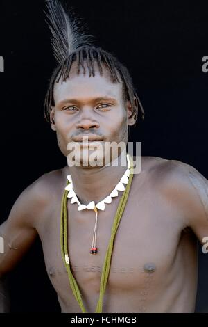 Young man of the Nyangatom tribe, Omo Valley, Ethiopia, Africa. - Stock Photo