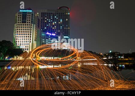 Steel wool spinning, Kuala Lumpur, Malaysia. - Stock Photo
