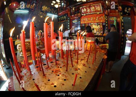 The worshippers praying for good fortune, Kuching, Sarawak, Malaysia. - Stock Photo