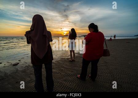 Sunset in Tanjung Aru, Kota Kinabalu, Sabah, Malaysia. - Stock Photo