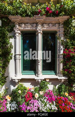 Close up of a window with lots of flowers at Hearst Castle, California, USA - Stock Photo