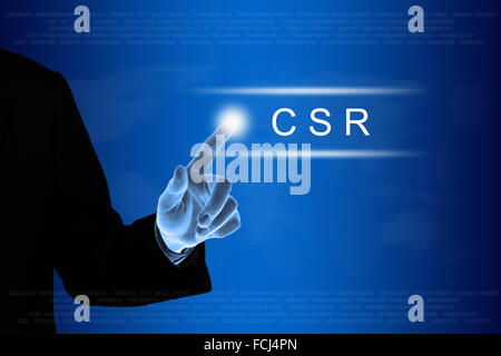 business hand pushing CSR or Corporate social responsibility button - Stock Photo