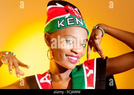 Young Kenyan woman with Kenyan colors in studio setting. - Stock Photo