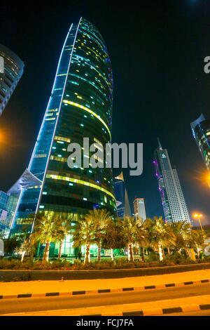 Modern Skyscraper, kuwait city, Sharq area of Downtown at night - Stock Photo