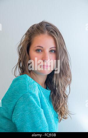 Portrait of pretty young woman looking camera. - Stock Photo