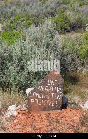 Guru saying rock, Guru Road, Gerlach, Nevada. - Stock Photo