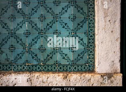 Traditional portuguese tiles,Blue azulejos on the building´s exterior in Lisbon, Portugal. - Stock Photo