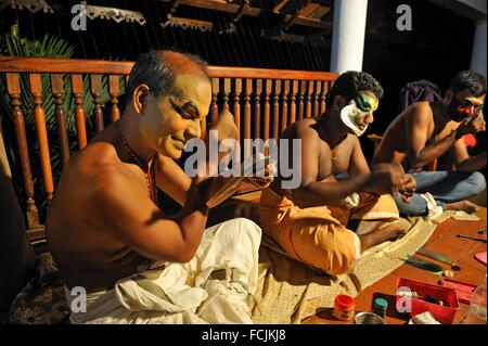 Kathakali performers during making up before a show at the Kumarakom Lake Resort hotel, Kerala state, South India, - Stock Photo