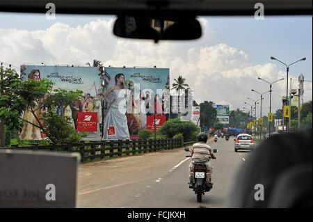 billboard along the road from the airport to Kochi or Cochin, Kerala state, South India, Asia. - Stock Photo