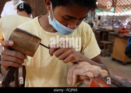 Artisans during the artistic craftsmanship at Artisans d´Angkor in Siem Reap, Cambodia - Stock Photo