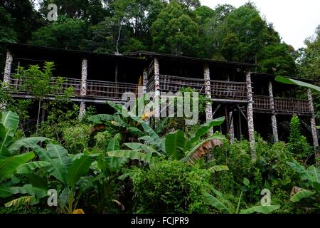 A typical Orang Ulu wooden house in Sarawak Cultural Village, sarawak, malaysia - Stock Photo