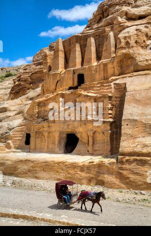 Tourist in Horsecart, Obelisk Tomb (upper structure), Bab-as Sig Triclinium (lower Structure), Petra, Jordan - Stock Photo