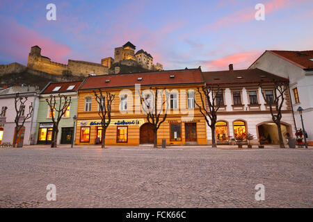 Trencin castle as seen from the main square in the old town. - Stock Photo
