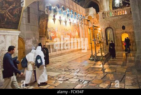 On background Stone of Unction, Church of the Holy Sepulchre, Old City, UNESCO World Heritage Site, Jerusalem, Israel. - Stock Photo