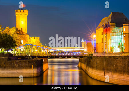 Germany Cologne Rheinauhafen Malakoff Tower and Imhoff chocolate museum at blue hour - Stock Photo