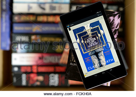 Claire North 2014 novel The First Fifteen Lives of Harry August, digital book cover on PC tablet, England - Stock Photo