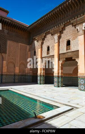 Berber arabesque Morcabe plasterwork of the 14th century Ben Youssef Madersa (Islamic college) re-constructed by - Stock Photo