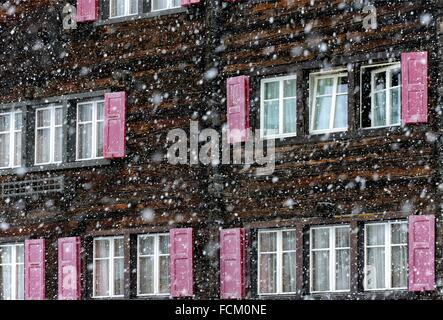 facade of typical, wooden Swiss chalet in winter, Saas-Fee, Valais, Switzerland. - Stock Photo