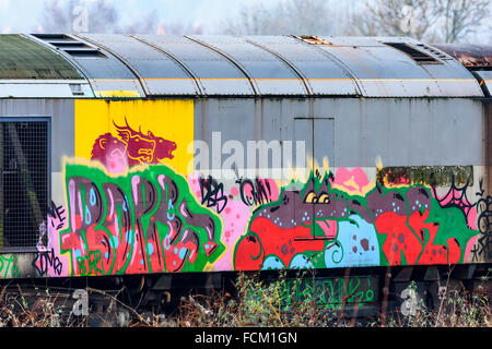 Graffiti painted onto the side of a disused Class 60 diesel loco at Toton depot in Nottinghamshire - Stock Photo
