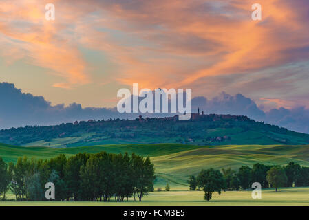 The medieval town of Pienza at colorful sunset - Stock Photo
