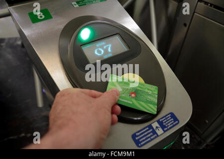 Placing an electronic ticket on the automated entrance to a Metro station in Saint Petersburg, Russia. - Stock Photo