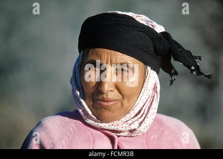 Portrait of a Turkish Peasant  Woman Wearing a Traditional Head-dress or Head Scarf in Western Turkey - Stock Photo