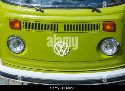 A green Volkswagen kombi van - Stock Photo