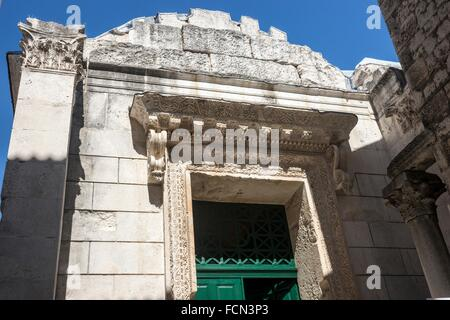 Facade, The Baptistery, formerly the Roman Temple of Jupiter, with its famous 11th century baptismal font and sculpture - Stock Photo