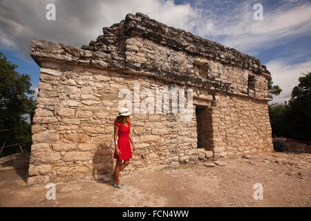 Tourists near the temple on the top of the Nohoch Mul Pyramid at the Prehispanic Mayan city of Coba Archaeological - Stock Photo