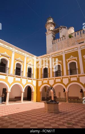 Courtyard of the Benemerito Instituto Campechano Institute with the San Jose Church in the background, Campeche, - Stock Photo