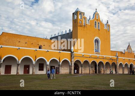 Tourists in front of the Monastery, Convent Of San Antonio De Padua, Izamal, Yucatan, Yucatan Province, Mexico, - Stock Photo