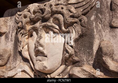 Medusa head in the Temple of Apollo at the Archeological area of Didim, Didyma, Aydin Province, Turkey, Europe. - Stock Photo