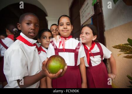 School children with uniform at the school, Trinidad, Sanctí Spíritu, Cuba, West Indies, Central America. - Stock Photo
