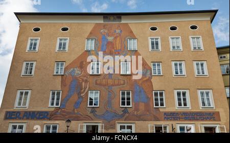 Anker (anchor) house with huge sundial on Waagplatz in Salzburg, Austria - Stock Photo